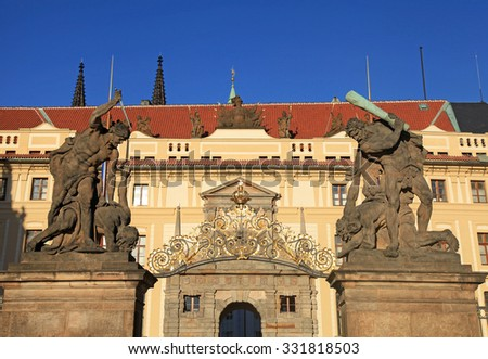 Old statues decorate the Western gate to the Prague Castle in sunny day, Czech Republic - stock photo