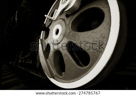 Old steam engine wheels close-up. Grunge - stock photo