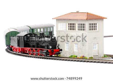 old steam loco model with passenger cars isolated over white background - stock photo