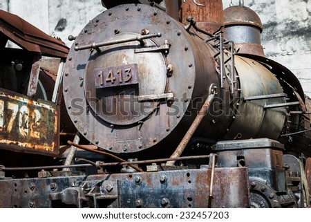 old steam locomotive on the background wall - stock photo