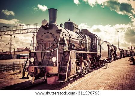 Old steam locomotive, vintage train. - stock photo
