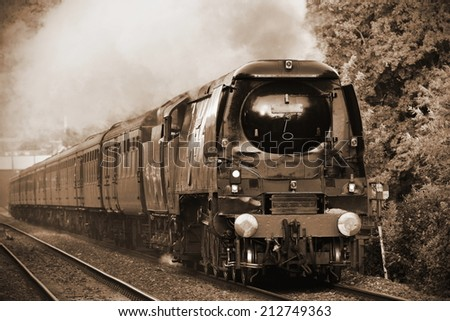 Old Steam Train in Sepia - stock photo
