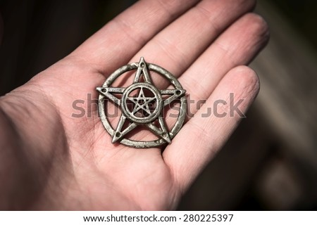 Old steel Pentagram closeup photo on background - stock photo