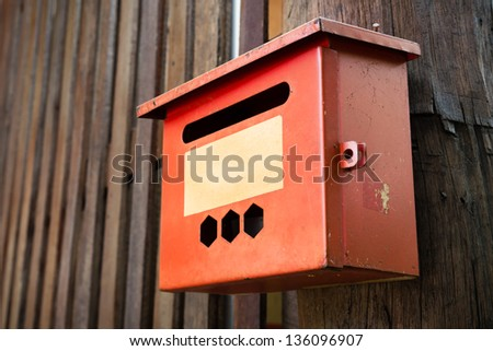 Old Steel Red Mail Box Hang on Wood Wall - stock photo