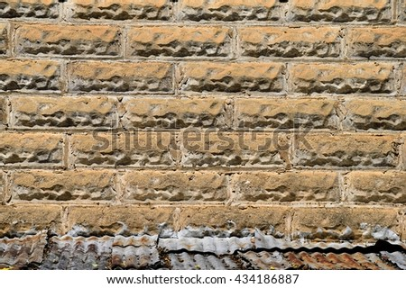 Old stone brick wall exterior background - stock photo