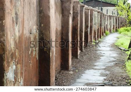 Old stone fence - stock photo