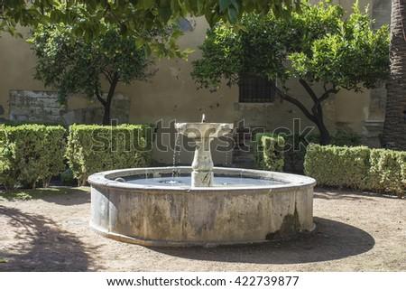 Old stone fountain in Cordoba - Spain - stock photo