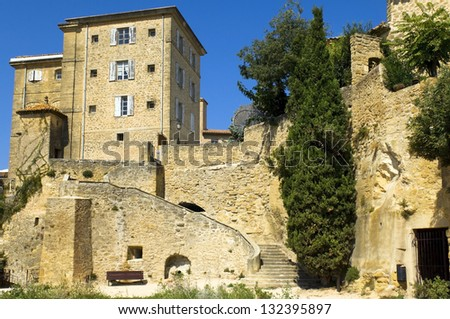old stone house built on the rock, region of Luberon, Provence, France - stock photo