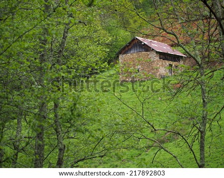 Old stone house on mountain - stock photo