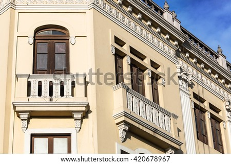 old stone house with beautiful balconies - stock photo