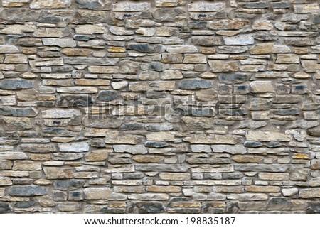 Old stone masonry seamless texture - stock photo