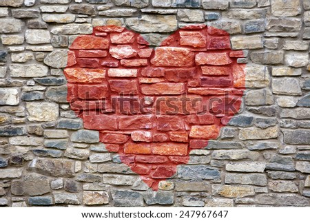 Old stone masonry texture, picture of red heart fof Valentine`s  - stock photo