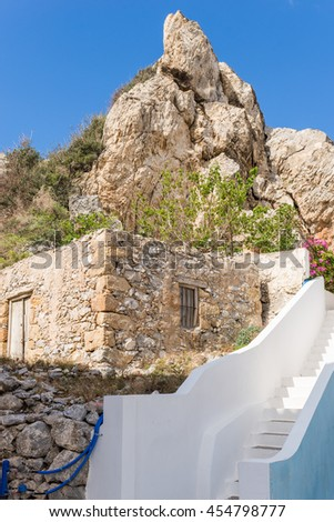 Old stone shed at the hillside in Paleochora on Crete. The rock looks like a jelly bag cap. The town, situated in the southwest coast of Crete, is a popular tourist destination - stock photo