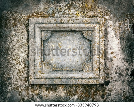 Old stone signboard with moss - stock photo