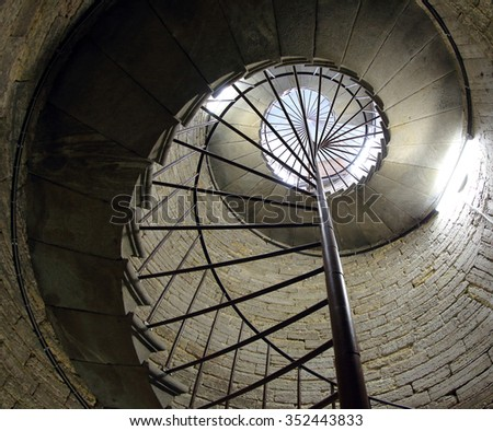 Old stone spiral staircase, background. - stock photo