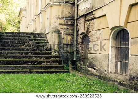 Old stone stairs to the castle overgrown with moss - stock photo