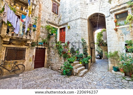 Old stone street of Trogir UNESCO world heritage town in Dalmatia, Croatia - stock photo