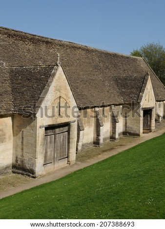 Old Stone Tithe Barn in the Historic Town of Bradford on Avon in Wiltshire England - stock photo