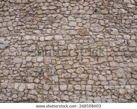 old stone wall as background, Cracow Wawel Royal Castle buildings - stock photo