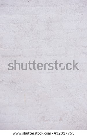 Old stone wall background with rough block structure. Worn and grungy surface of building exterior. - stock photo