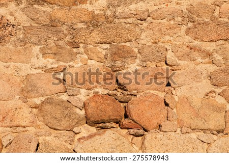 Old stone wall to use as wallpaper - stock photo