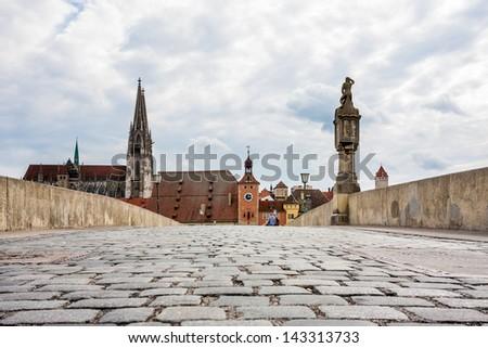 Old stony bridge in Regensburg - stock photo