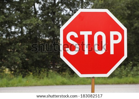 old STOP traffic sign. - stock photo