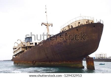 old stranded tanker ship - stock photo