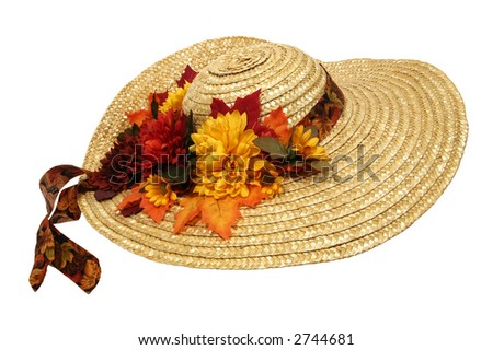 old straw bonnet with faded flowers - stock photo