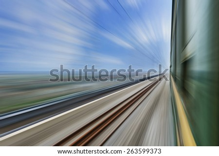 old stream green train that runs through the countryside - stock photo