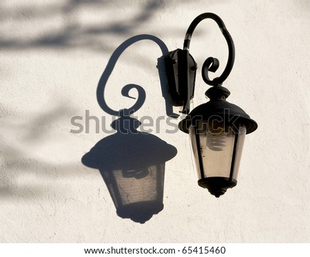 Old street lamp with modern electric bulb - stock photo