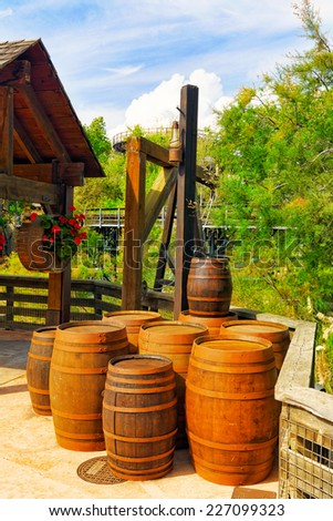 Old street  with wine barrels.Wild West. - stock photo