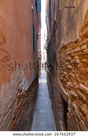 Old streets in Venice showing how narrow some of the streets are. - stock photo
