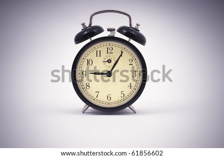 Old style alarm clock close up with vignette - stock photo
