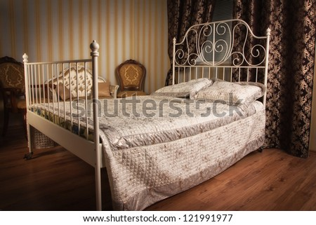 Old style bed in the elegant bedroom - stock photo