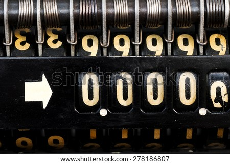 old  style cash register with  numbers 00000 crisis  close up - stock photo