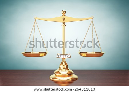 Old Style Classical gold scales on the table - stock photo
