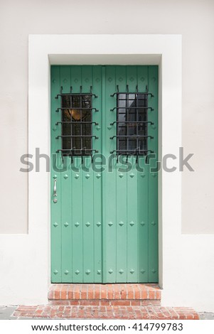 Old style front door and wall with natural light - stock photo