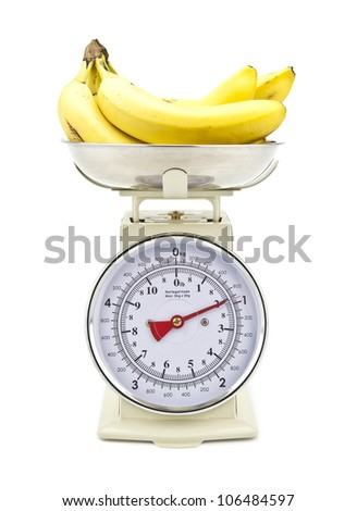Old style kitchen scales with Bananas on white background Isolated - stock photo
