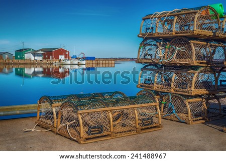 Old style lobster traps on a wharf if rural Prince Edward Island, Canada. - stock photo