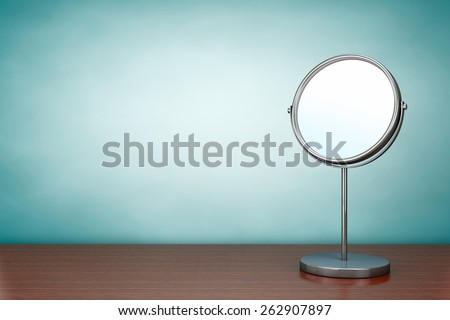 Old Style Photo. Chrome Makeup Mirror on the table - stock photo