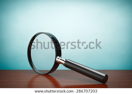 Old Style Photo. Magnifying Glass on the table - stock photo
