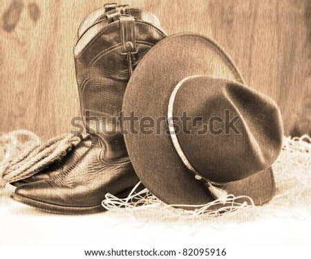 old style picture of cowboy boots and hat - stock photo