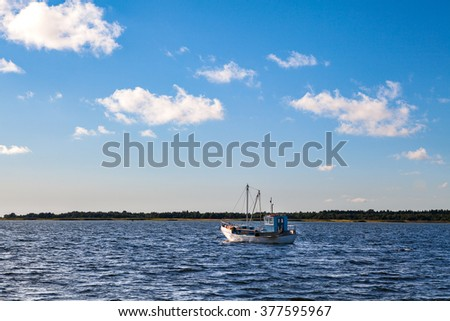 Old style wooden fishing boat in the Baltic Sea - stock photo