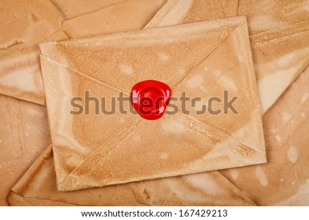 Old styled envelope with empty red sealing wax stamp  - stock photo
