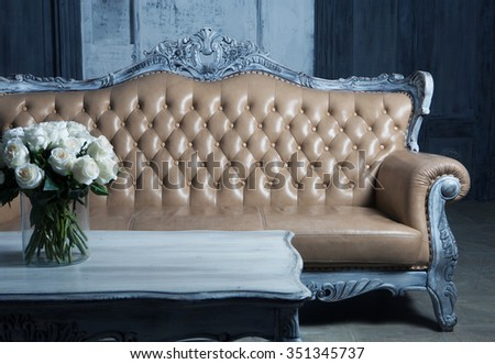 Old Styled Interior, blue tones: sofa and roses - stock photo