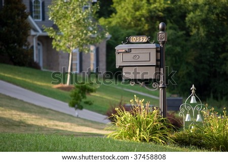 Old-styled mailbox with ornament - stock photo