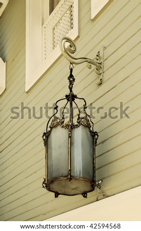 Old stylish lamp on a Istanbul Street (1910) - stock photo