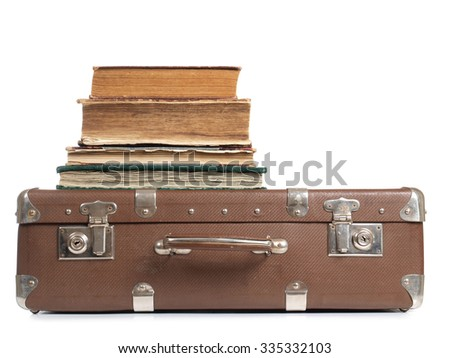 Old suitcase and a book on white background       - stock photo