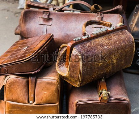 old suitcases at a flea market - stock photo